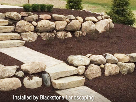boulders and mulch in a landscape